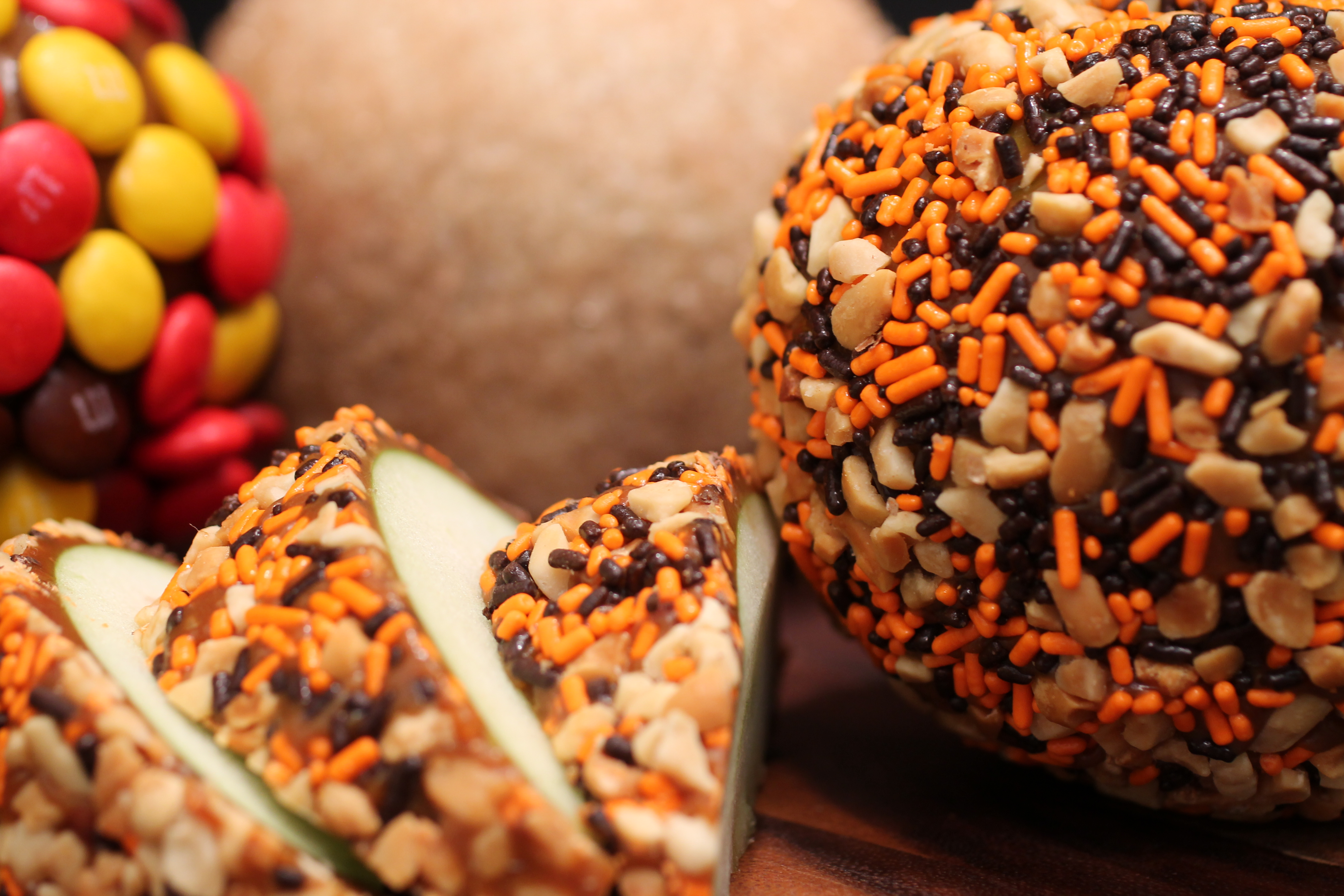 Taffy apples with candy and nut toppings