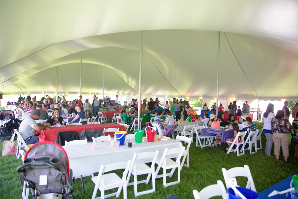 Employees enjoy lunch at their corporate picnic