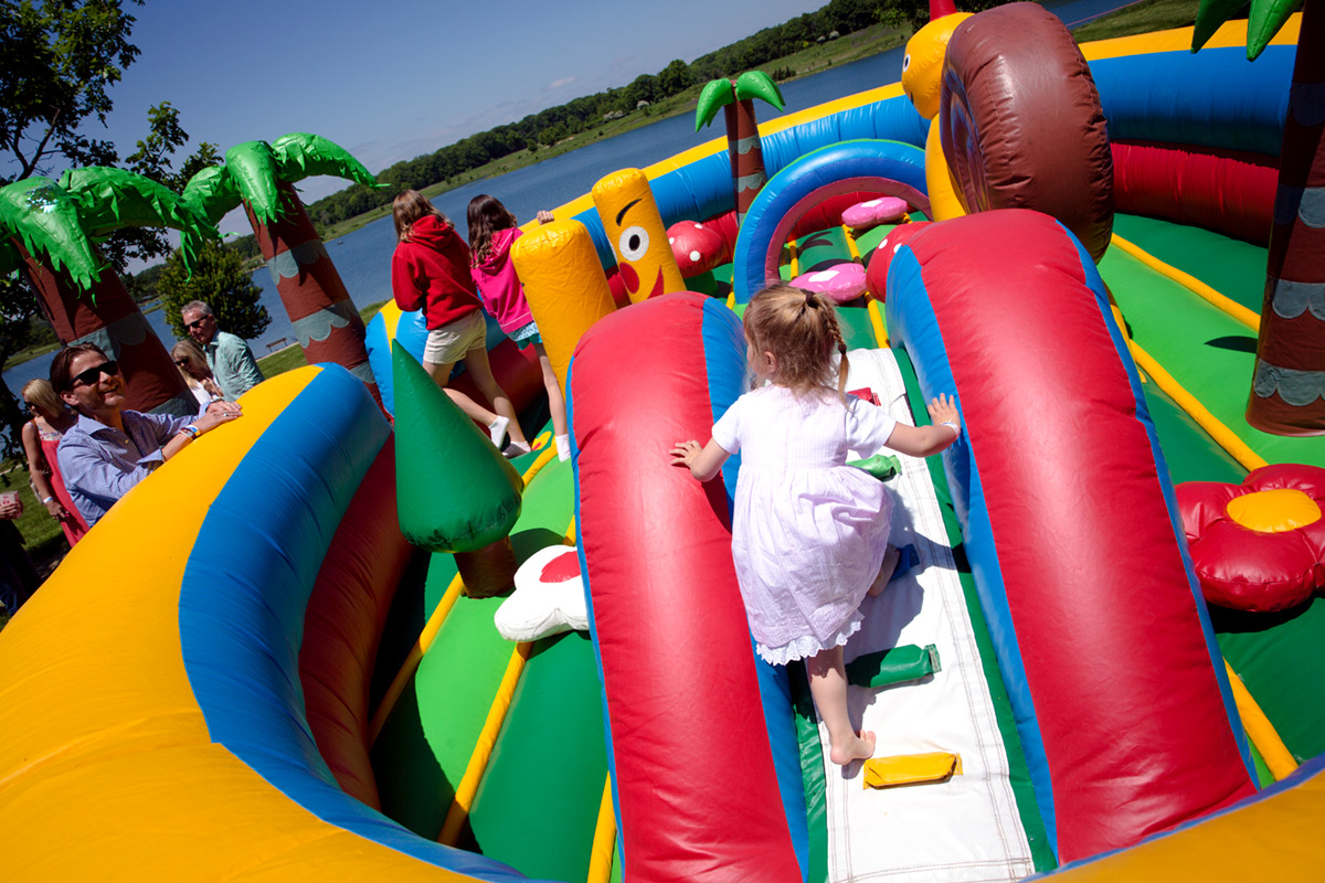 Kids playing in bounce house slide at Independence Grove