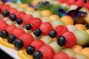 Graduation party catering gourmet fruit kebobs